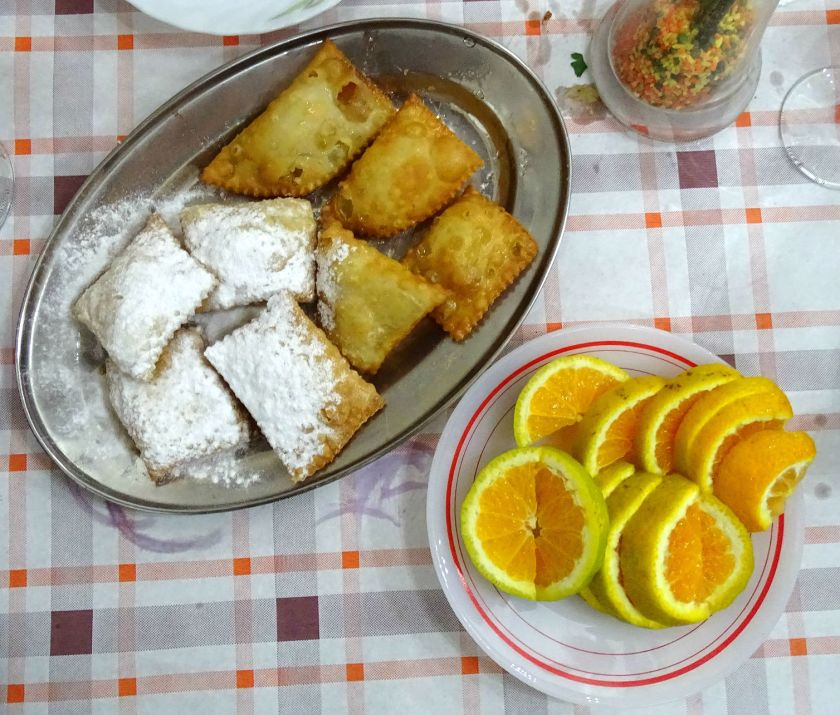 Traditional pourekkia served with freshly cut orange slices
